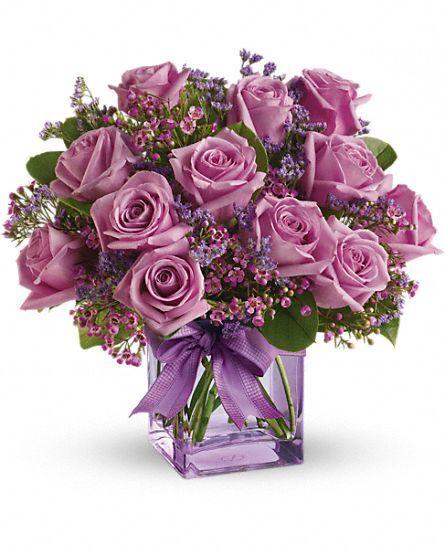 Букет із бузкових троянд з декором