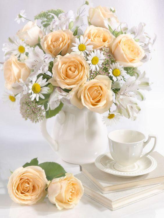 Ніжний букет із троянд та ромашок на кухні