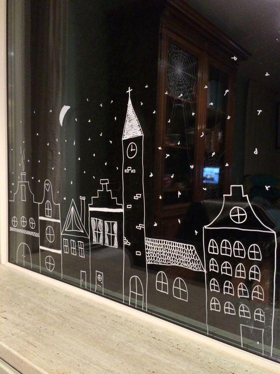 Малюнок із зимовим містом на вікні