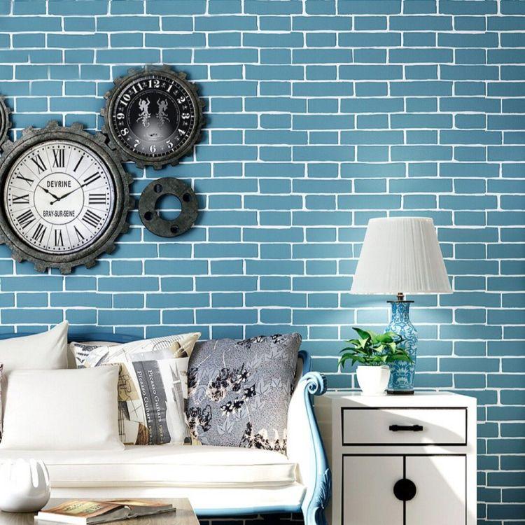 Сині відтінки вітальні з білими меблями