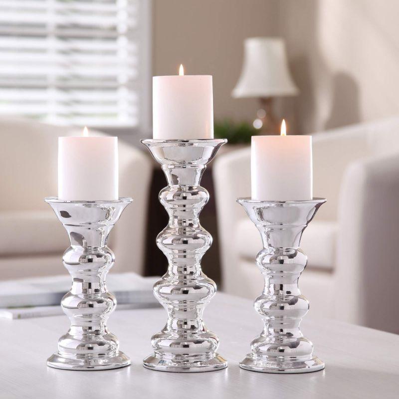 Прозорі скляні свічники згодяться для будь-якого сезону
