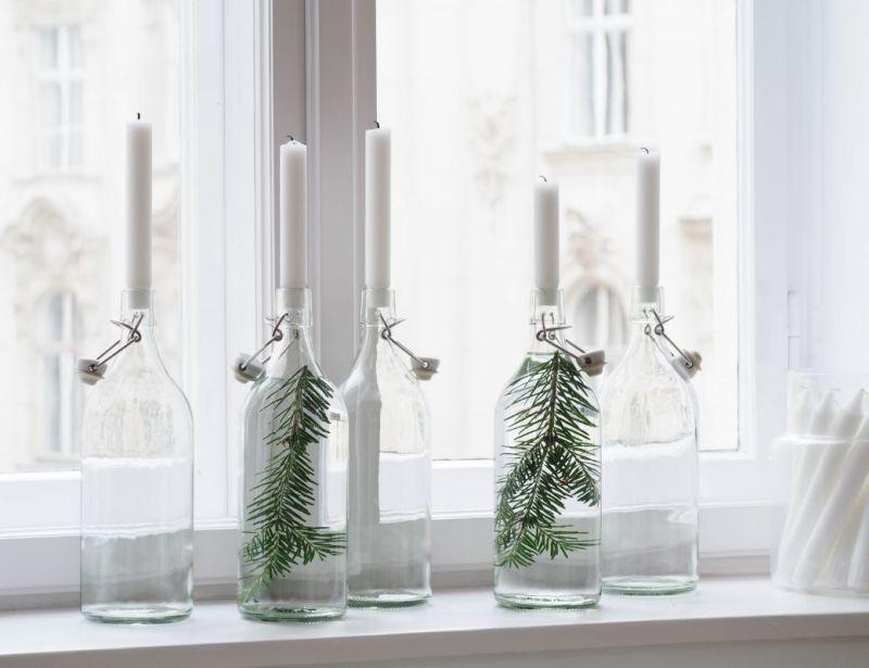 Декоровані скляні пляшки зі свічками