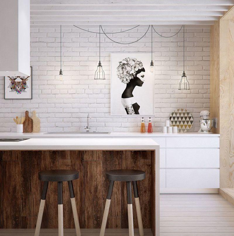 Пофарбована у білий колір цегла на робочій стіні у кухні