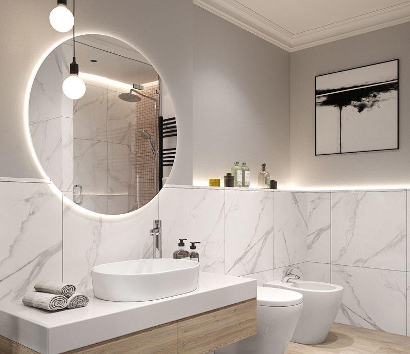 Кругле дзеркало в інтер'єрі ванної кімнати: практичне рішення, що гармонійно поєднується з будь-яким стилем.