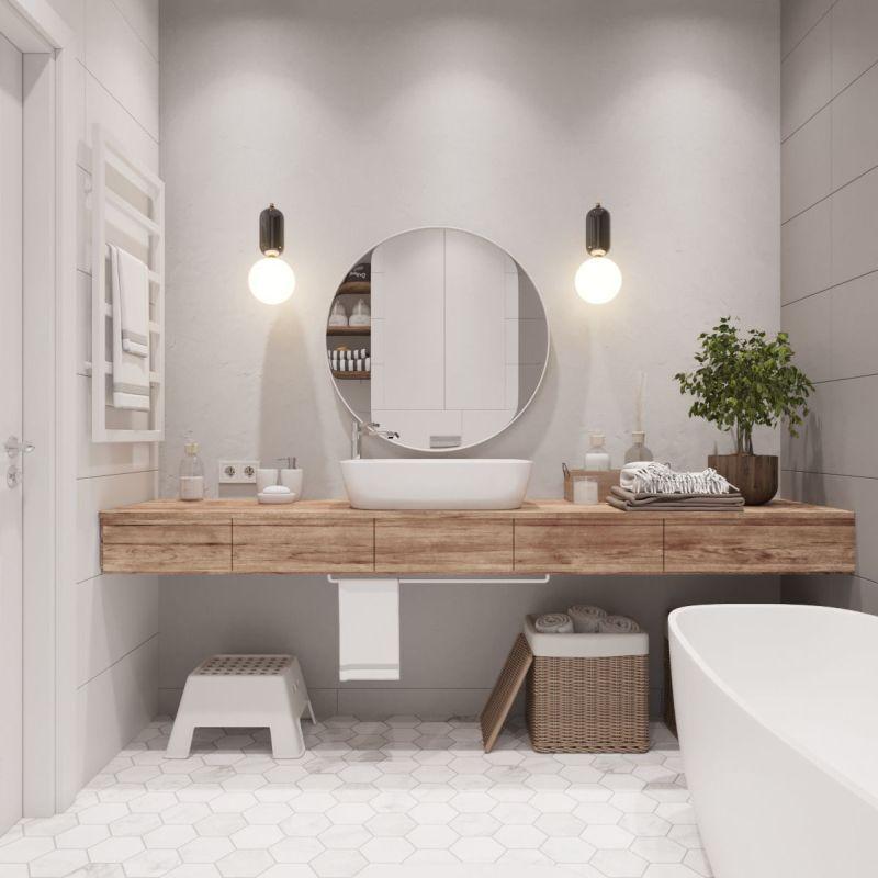 Ванна кімната з елементами еко стилю та круглим дзеркалом