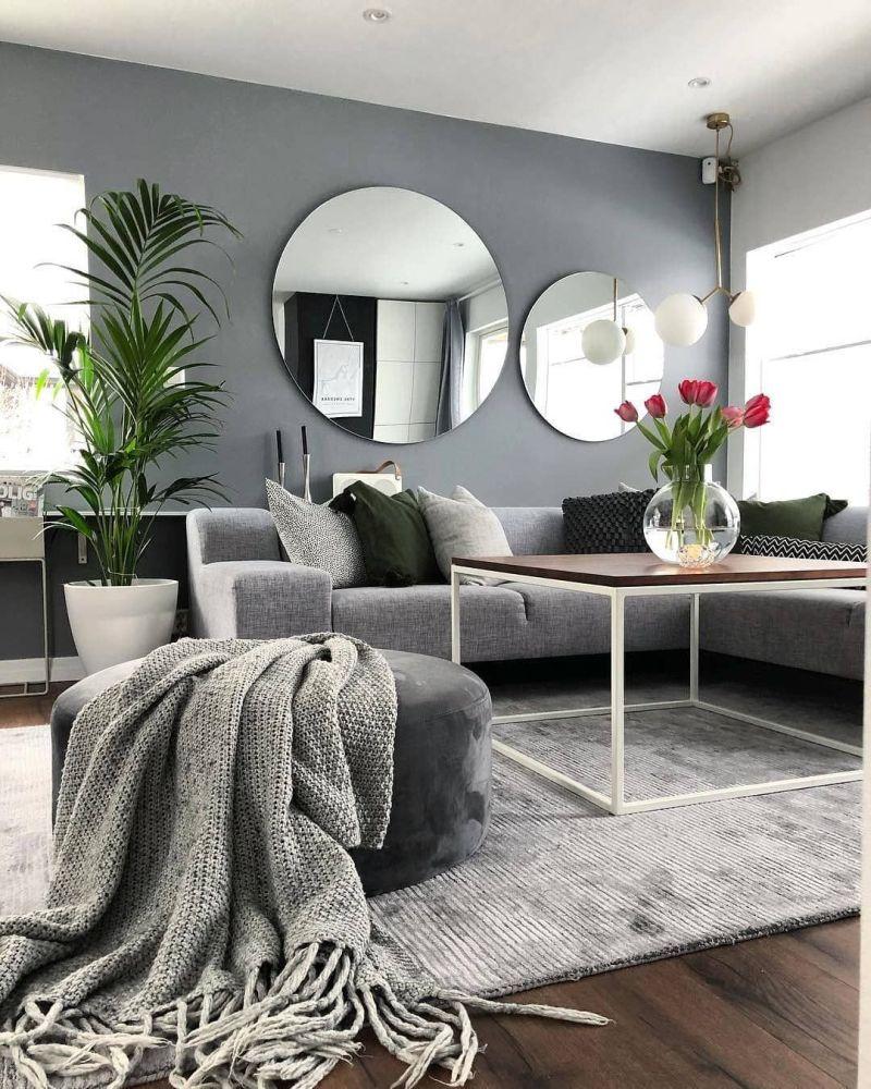 Вітальня у скандинавському стилі з круглими дзеркалами в інтер'єрі.