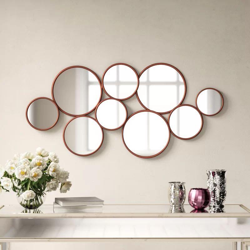 Композиція з невеликих круглих дзеркал