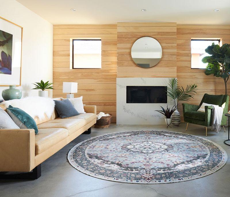 Привабливий дизайн круглого килима привертає увагу в інтер'єрі