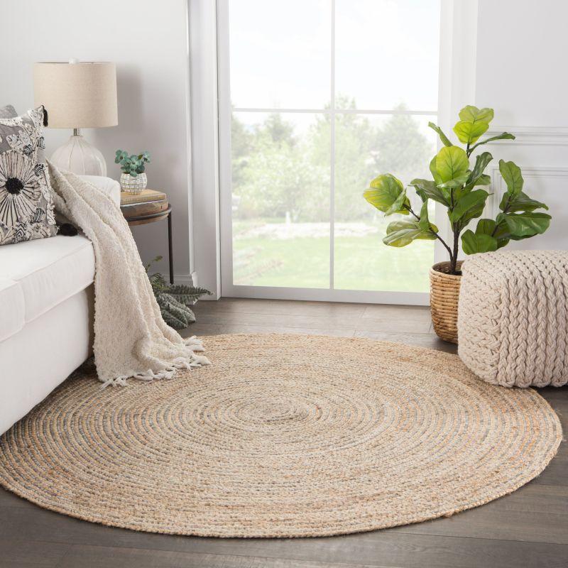 Плетений круглий килим в стилі кантрі