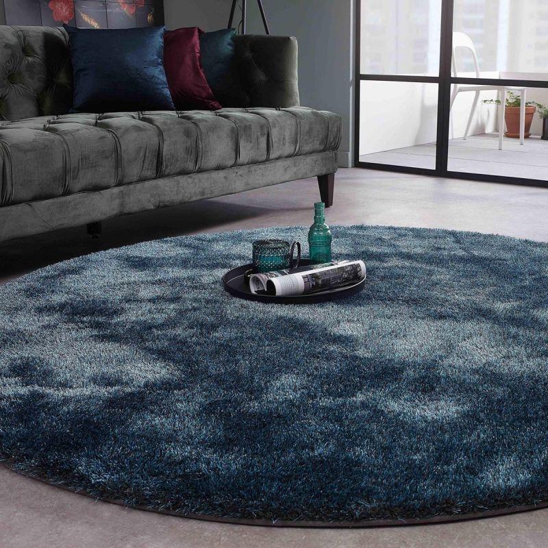Пухнастий круглий килим для сучасних віталень