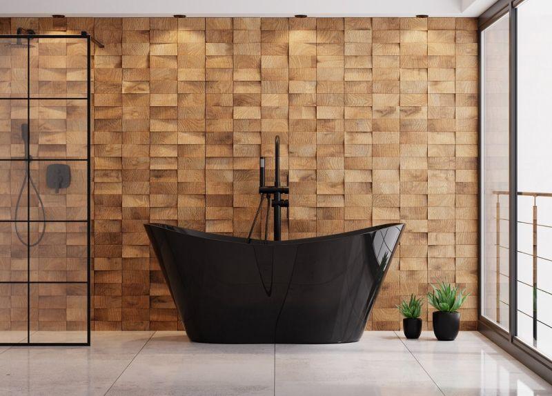Скляна перегородка гармонійно доповнює стильний дизайн ванної кімнати